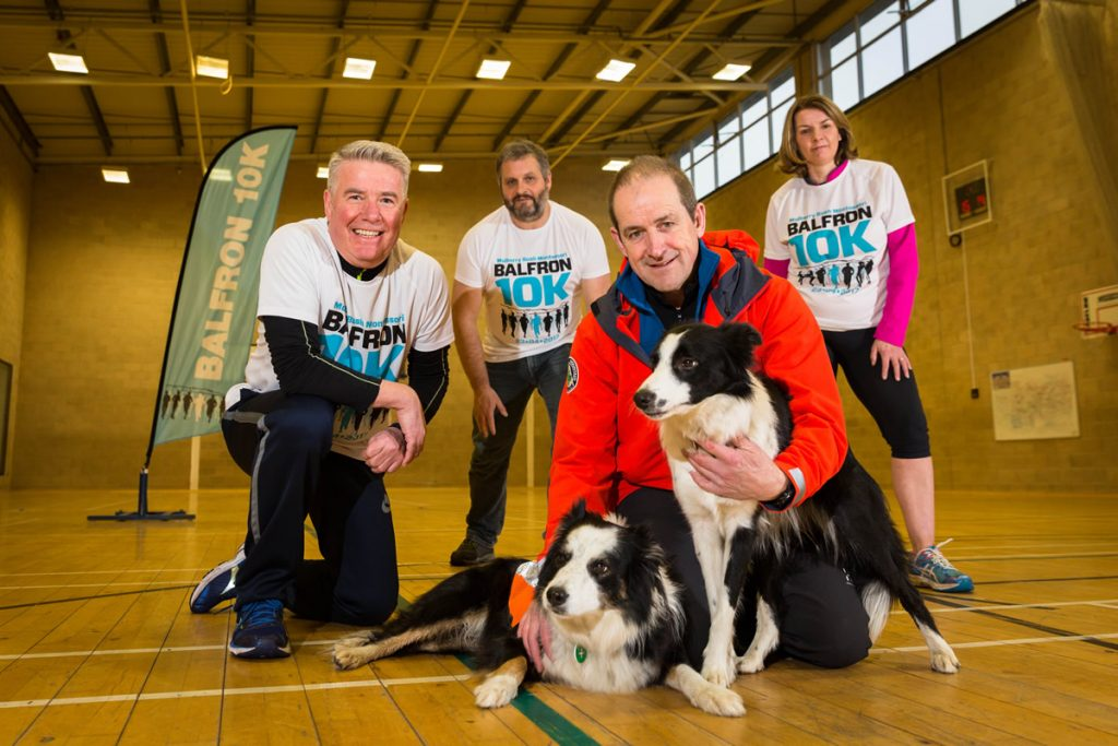 Launch: Lomond Mountain Rescue Team volunteer Alan McGowan with his dogs Molly and Nell is pictured front with 10k committee members David Ross, Derek Townsend and Julie Ross at the launch of the 2018 event. Picture by Ashley Coombes Photography.
